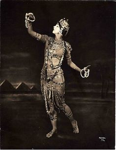 When I first saw a black and white photograph of Ruth St. Denis, I was instantly seduced by her, just as many audiences of the early 20th century were too. Who was this female chameleon from another era dressed as an Egyptian Goddess, a Hindu deity, a gypsy princess, a geisha or even as an Indian