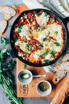 Shakshuka (Baked eggs in Tomato Sauce) with Broiled Feta. This delicious Shakshuka recipe (baked eggs in spicy tomato sauce) is topped with broiled feta and za'atar.