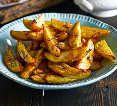 Spice up potato wedges with turmeric, ginger, garlic and fennel seeds for an Indian-inspired side dish - perfect to share with friends Bbc Good Food Recipes, Easy Dinner Recipes, Indian Food Recipes, Vegetarian Recipes, Healthy Recipes, Uk Recipes, Curry Recipes, Diabetic Recipes, Potato Recipes