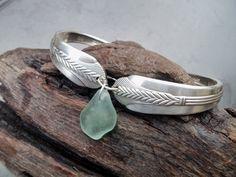 Sea glass jewelry,  Seafoam green sea glass on repurposed vintage silverplated flatware bracelet. $29.00, via Etsy.