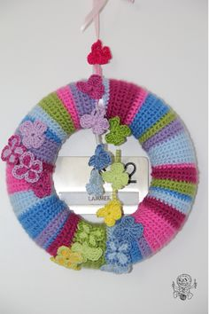 Pattern for Butterfly wreath: Yarn: SMC Bravo, 100% acrylic, 50 g/133 m, original Gauge 10 x 10 cm:  22 stitches  x 30 rows Gauge of crocheted cover: 10x10 cm = 21 sc x 22 rows Hook: 3 mm Stitches used: chain (ch), single crochet (sc) Supplies:...