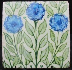 """William De Morgan Tile decorated with three flowers  6""""  Dated: 1888 - 97  www.adantiques.com"""