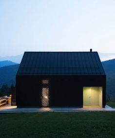 Black-painted larch clads this small house in Croatia, designed by architect Tomislav Soldo for a hill overlooking forests and mountains.Soldo designed the two-storey Black Lodge for a sloped site in … Space Architecture, Residential Architecture, Small Buildings, Cottage, Modular Homes, Black House, House Design, House Styles, Croatia