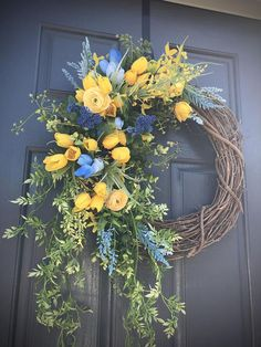 Blue Yellow Spring Wreath - What a gorgeous combination blue and yellow make! This wreath has mini tulips, boxwood and other greenery creating a flowing wreath Diy Spring Wreath, Spring Door Wreaths, Easter Wreaths, Wreaths For Front Door, Diy Wreath, Grapevine Wreath, Tulip Wreath, Floral Wreath, Fabric Wreath