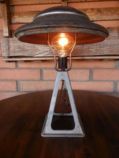 Hey, I found this really awesome Etsy listing at https://www.etsy.com/listing/288456365/hub-cap-jackstand-lamp