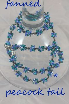 FANNED PEACOCK TAIL: $19.99..royal blue, aqua blue, jade with black twine. INTERCHANGEABLE JEWELRY CHAINS that becomes a: lanyard, necklace, choker, belt, or eyeglass chain. Includes gift packs with all connector pieces needed.