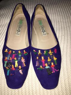 "Adorable periwinkle/purple suede and leather ship on loafers with miniature fabric ethnic ""dolls"" on the front.  Made in Italy Size 8.5 Great condition. Lightly worn and cherished by my Mother as one of her special things. Arnold Churgin shoes was often noted as one of the best shoe"