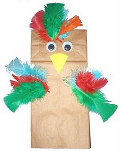 bird paper bag puppet- Made by attaching feathers, a beak and some eyes+ Brazil Rain Forest preschool craft Bird Crafts Preschool, Preschool Craft Activities, Daycare Crafts, Toddler Crafts, Crafts For Kids, Children Crafts, Craft Kids, Preschool Christmas, Daycare Ideas