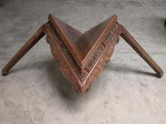 Ai Weiwei playing with ancient furniture