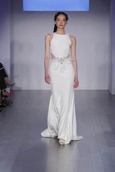 Jim Hjelm Fall 2015 sheath column silk satin wedding dress with jewel neckline and feather detail