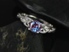 This engagement ring is a Celtic knot inspired design. It is simple yet unique. The alexandrite gives a modern touch to the traditionally inspired