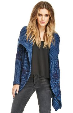 Medium-weight cardigan featuring a draped open design, mixed pattern knit, two hip pockets, and a draped collar.