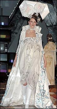 Christian Dior Spring 2005 Haute Couture: An embroidered coat with a high collar over a Directoire-style dress with a empire waist John Galliano, Christian Dior, Empire Silhouette, Empire Style, Fashion Seasons, High Collar, Fashion Photography, Fashion Dresses, Spring Summer