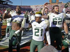 Baylor Bears defensive end Shawn Oakman (left) and safety Patrick Levels (21) and offensive lineman Tyler Edwards (62) celebrate after the game against the Oklahoma Sooners. (3603×2654)