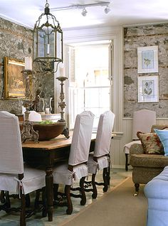 Love the stone, the white chairs, the light.  Love it all!
