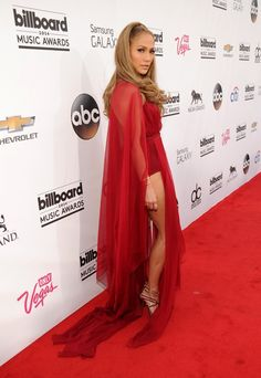 Pin for Later: Wolf Beware! Jennifer Lopez Is the Sexiest Little Red Riding Hood Ever Jennifer Lopez in Donna Karan at the 2014 Billboard Music Awards Lopez offered up a sneak peek of her strappy metallic sandals through the gown's sexy slits.