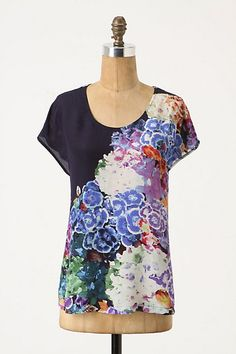 Love this feminine top from Anthropologie. Perfect tucked in with a pencil or over worn out jeans..