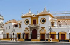 10 places to see in Seville, Spain - La Carte Vintage Places In Spain, Places To See, San Francisco Javier, Africa Destinations, Concrete Building, Main Entrance, Moorish, Beautiful Buildings, Spain Travel
