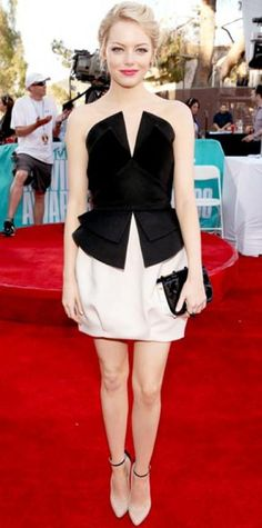 Look of the Day › June 4, 2012  WHAT SHE WORE Stone walked the red carpet at the MTV Movie Awards in a black and white ensemble by Martin Grant. She completed the look with a satin Fendi clutch, Tiffany & Co. jewels and ankle-strap Brian Atwood pumps.