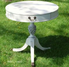 Antique drum table refinished in CeCe Caldwell's Vintage White and Pittsburgh Gray ~ read entire post at: http://alittlebitoshizzle.blogspot.com/2012/04/vintage-white-drum-table-with-gorgeous.html