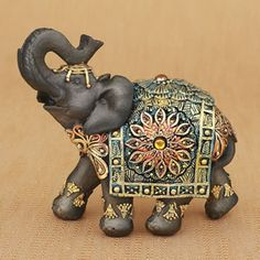Mahogany+Brown+elephant+with+colorful+headdress+and+blanket+-+medium+size