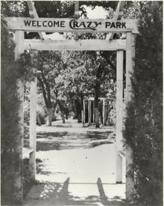 Shown here is the entrance to Crazy Park, Mineral Wells, Texas, a picture taken in 1938. This park was earlier a part of the Gibson Pavilion and Park in the 700 block of NW 2nd Avenue. It was located a block south of the Crazy Water Crystals plant, built in 1919. The property now [2008] belongs to, and is occupied by, the First Christian Church.