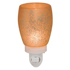 The perfect sigh of warm, speckled light with a lovely cream glow.  This plug in is gorgeous and can go with anything!!!  https://brittanyr.scentsy.us/Buy/ProductDetails/29881