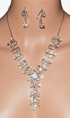 http://www.bijoux-feminin.com/parure-pierres-blanches-c2x14763296