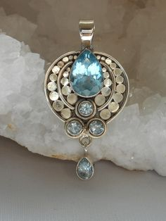 Handmade gorgeous Swiss Blue Topaz gemstone pendant with large faceted teardrop center stone and 4 faceted Swiss Blue Topaz accent stones including teardrop dangle, set in 925-hallmarked sterling silv