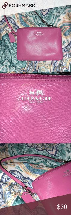 Pink Coach Wristlet Almost new with tag. It still has the plastic tie from the tag. Never used.   Smoke free home Bags Clutches & Wristlets