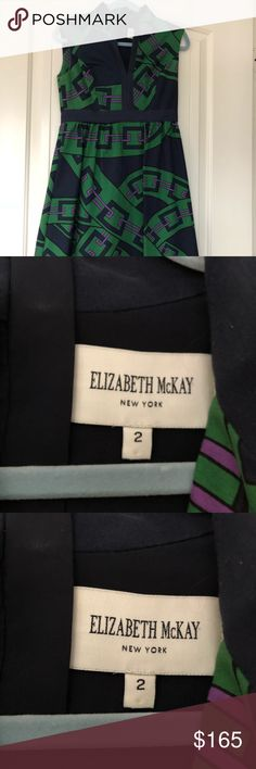 Elizabeth McKay cotton blend a line dress Bold navy, green and touches of purple make for a statement dress.  Worn only once for a work event this is in almost brand new condition.  Cotton blend with full lining. Elizabeth McKay Dresses Midi