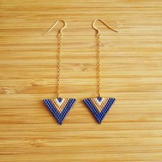 Dangling earrings form sewn triangle hand with Miyuki delicas blue matte, Golden and white beads marine broken mast. String and tie plated or gold