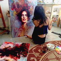 Contemporary figurative artist Charmaine Olivia painting in her art studio #workspace. charmaineoliviashop.com