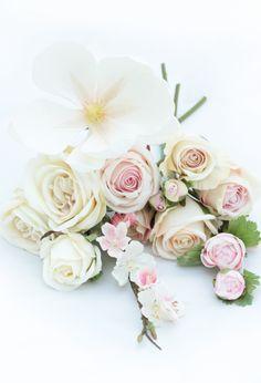 Pearl magnolia, cream English roses, cream/pink garden roses, pink ranunculi and cherry blossom