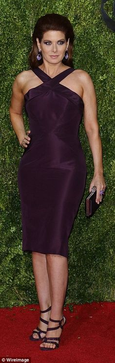 Purple reign! Debra Messing showcased her curves in a halter style purple dress...