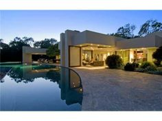 "A unique, ""Nature Meets Art,"" backyard and pool area. Rancho Santa Fe, CA Coldwell Banker Residential Brokerage $7,495,000"