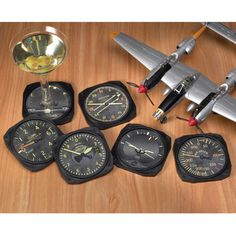 """Vintage Instrument Coasters Set of 6 These Vintage Instrument Coasters are antiqued to resemble instruments from vintage aircraft. Each set is complete with Altimeter, Artificial Horizon, Air Speed Indicator, Rate of Climb Indicator, Turn & Slip Indicator, and RMI. To prevent sliding, they feature a soft, durable foam texture backing. Coasters are 3.25"""" or so in dia."""