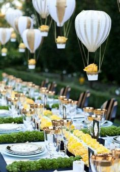 Entertaining table setting idea for wedding reception, engagement party, baby or bridal shower, birthday party lunch featuring hot air balloons, yellow roses, gold rim wine champagne glass ware