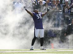 Ravens linebacker Terrell Suggs poses for the crowd before a 2006 game against the Panthers. Suggs is likely out for 2012 after tearing his Achilles tendon during a conditioning test, though Suggs insists he'll return in late October or November. (Damian Strohmeyer/SI)