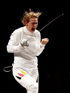 Britta Heidemann of Germany celebrates defeating Shin A Lamof Republic of Korea during the women's Epee Individual Fencing semi-finals on Day 3 of the London 2012 Olympic Games at ExCeL.