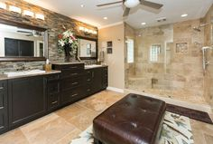 Rustic Master Bathroom with limestone tile floors, Quoizel Lighting Bathroom Light, Tufted Chocolate Brown Faux Leather Bench