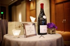 Instead of a guests signing a picture frame, this idea uses a bottle of wine.