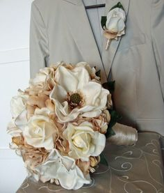 magnolia wedding flowers - i kinda like this! Add in the wedding color and some burlap flowers and twine and I'll love!