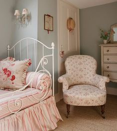 white cast iron bed.  French General fabric bedding.  Gorgeous chair.