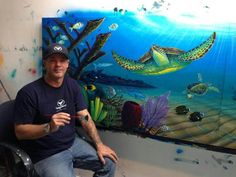 Wyland .  We visited his gallery in Hawaii and were lucky enough to meet him there.  Fabulous artist, nice guy!