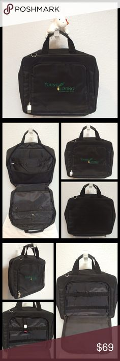 """YOUNG LIVING Black Briefcase Laptop Case Bag New Black Nylon Briefcase. Perfect for Essential Oils (EO's) business! I have 2, keeping 1 for my business.   Holds notebooks, pens, brochures, books & laptop (padded pocket). 😀 Front zippered pocket w/21 EO bottle holders! Bottle in pic NOT included.   *I'm a Young Living Rep & sell EO products off Poshmark (I follow rules).  DIMENSIONS Width: 14 3/4"""" Height: 12"""" Depth: 3 1/4"""" Handle Drop: 5""""   🏆 Suggested User 💗Bundles 👍🏼Reasonable Offers…"""