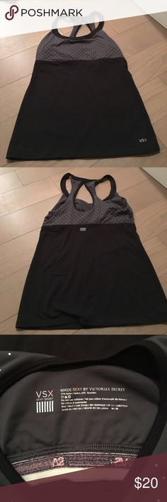 Victoria secret workout top Victoria secret workout top with built in bra. Silver studs on the top in the gray area Victoria's Secret Tops Tank Tops