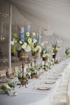 Click this pin!!!  This is just one photo of many of this really beautiful and romantic looking wedding.  LOVE the blue delphiniums in the flower arrangements!