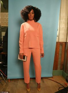 Stylish: Solange brought a retro look to the charitable event as she donned a chic, matchi...