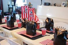A red, white, and black pirate tablescape for a boy's birthday party.